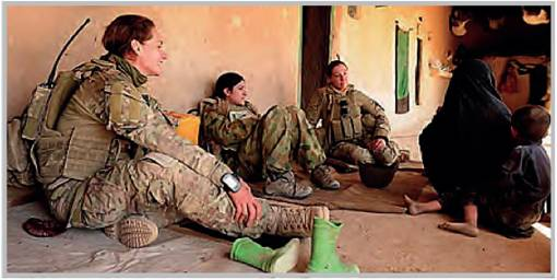 A Female Engagement Team from Mentoring Task Force Three speak with women in the Karmisan Valley, Afghanistan.