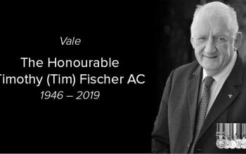 Vale, The Honourable Timothy (Tim) Fischer AC. 1946 – 2019. On the right hand side of the image is a photo of Tim Fischer.