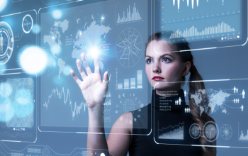 A woman holding her right hand up to a digital interface displaying various data