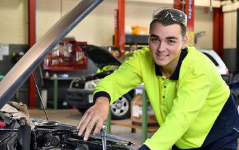 Year 12 automotive student poses for a photo at Southern Cross Vocational College in Sydney, Monday, June 18, 2018. (AAP Image/Joel Carrett)