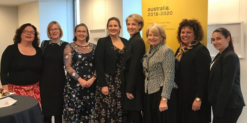 Minister for Women, Michaelia Cash, standing with a group of women.