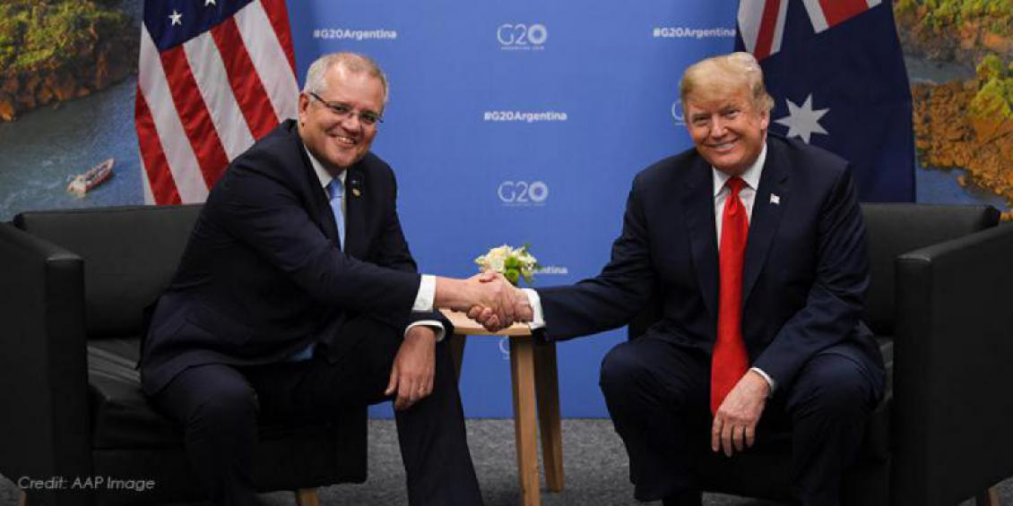 Prime Minister Scott Morrison and President Donald Trump smiling and shaking hands
