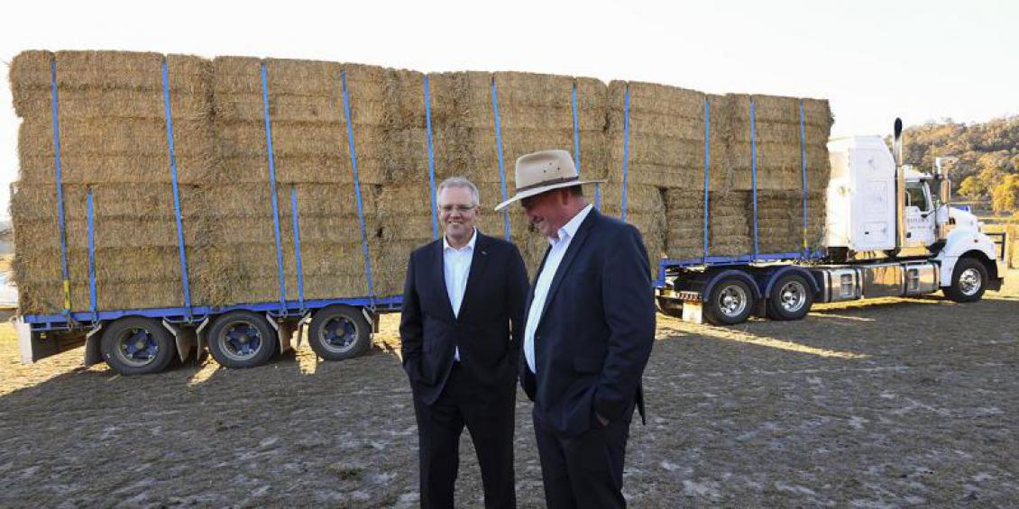 Australian Prime Minister Scott Morrison (left) and drought envoy Barnaby Joyce stand in front of a semitrailer during an announcement at Royalla near Canberra, Thursday, September 20, 2018. (AAP Image/Lukas Coch)