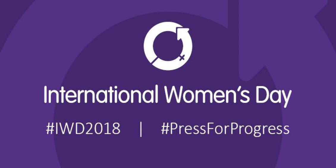 International Women's Day written over a purple background with the hashtags #Pressforprogress @IWD2018
