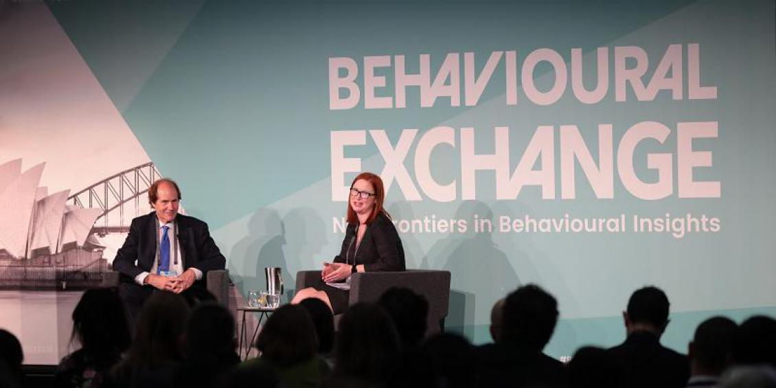 Cass Sunstein and Tara Oliver on stage at BX 2018 in Sydney