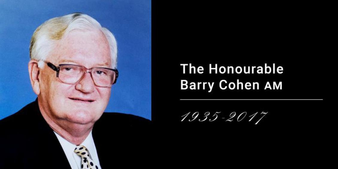 Portrait of older male wearing glasses, suit and tie. Overlaying text reads: The Honourable Barry Cohen AM 1935-2017.
