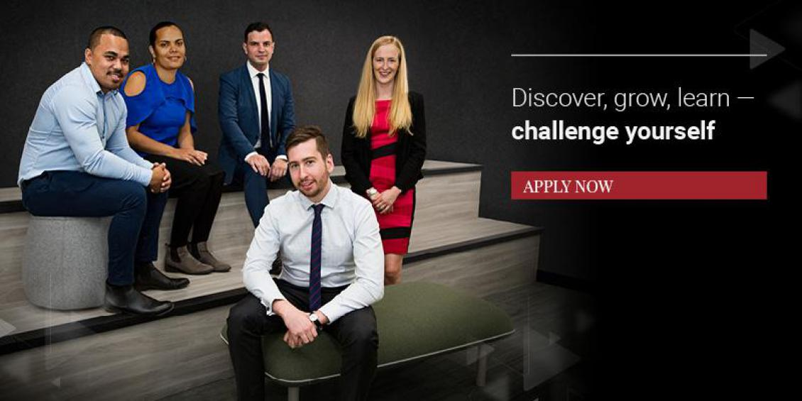 "Image of five PM&C graduates smiling, with text that reads ""Discover, grow, learn - challenge yourself. Apply Now"""